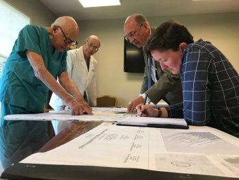 Dr. Buhite Sr. and Dr. Buhite Jr. meet with the architects for the Buhite-DiMino Center for Implant Dentistry