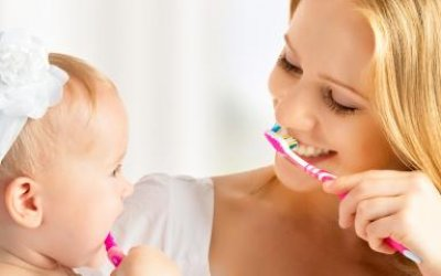 Mom and Baby Brushing Teeth